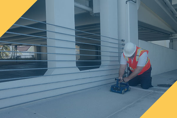 Certified Florida Concrete Scanning Professional using Ground Penetrating Radar on a Florida Private Utility Concrete Parking Structure | Florida Concrete Scanning